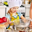 Stock Photo: Child bake cookies.
