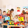 Foto Stock: Child painting at art school.