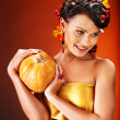 Woman holding autumn fruit. — Stok fotoğraf