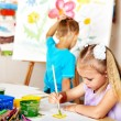 Stock Photo: Children boy and girl painting.