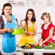 Family with grandmother and child at kitchen. — Stock Photo