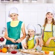 Stock Photo: Children bake cookies.