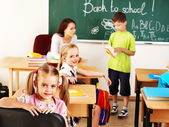 Children in classroom near blackboard. — Stock Photo