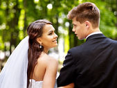Bride and groom outdoor. — Stock Photo