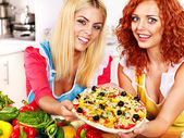 Women cooking pizza. — Stock Photo