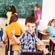 Stock Photo: School child writting on blackboard.