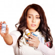 Stock Photo: Womhaving pills and tablets.
