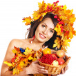 Stock Photo: Girl holding basket with fruit.