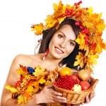 Girl holding basket with fruit. — Stock Photo #30744065