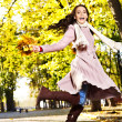 Woman wearing autumn coat outdoor. — Stock Photo