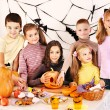Family with child holding make carved pumpkin. — Stock Photo