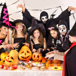 Halloween party with children holding trick or treat. — Stock Photo #30744191