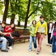 Group of people in city park listen music. — Stock Photo