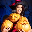 Witch holding pumpkin — Stock Photo