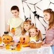Halloween party with children holding trick or treat. — Stock Photo #30744251