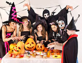 Halloween party with children holding trick or treat. — Stock Photo