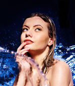 Wet woman face with water drop. — Stock Photo