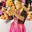 Children on Halloween party making pumpkin — Stock Photo