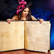 Witch woman holding open book. — Stock Photo
