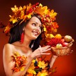 Woman holding autumn basket. — Stock Photo #31639115