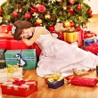 Child with gift box near Christmas tree. — Stock Photo
