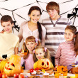 Family  with child holding make carved pumpkin — Stok fotoğraf