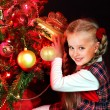 Child with gift box near Christmas tree. — Stock Photo #31639253