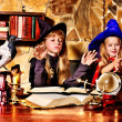 Stock Photo: Witch children with crystal ball.