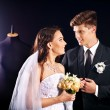 Couple try wedding dress in shop. — Stock Photo