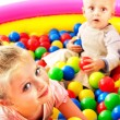 Child in colored ball. — Stock Photo #31639495