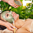 Clay facial mask in beauty spa. — Foto Stock #31639513