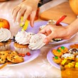 Halloween table with trick or treat and child hands. — Stock Photo