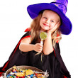 Witch  little girl with candy. — Stock Photo