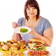 Woman choosing between fruit and hamburger. — Stock Photo #31639759