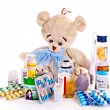 Child medicine and teddy bear. — Stock Photo #31639841