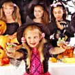 Halloween party with children holding trick or treat. — Stock Photo #31639887
