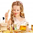 Stock Photo: Child cosmetics. Little girl with lipstick.