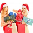 Girl in Santa hat holding Christmas gift box. — Stock Photo #31639989