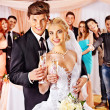 Wedding couple drinking champagne — Stock Photo
