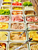 Tray with food on showcase at cafeteria — Stock Photo