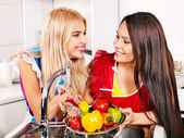 Two women preparing food at kitchen. — Stock Photo
