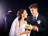 Couple try wedding dress in shop. — Stok fotoğraf