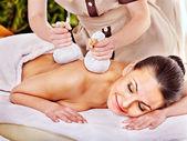 Woman getting herbal ball massage treatments . — Stock Photo