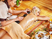 Woman getting stone therapy massage . — Stock Photo