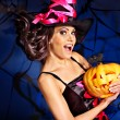 Witch holding pumpkin — Stock Photo #31640019