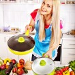 Housewife cooking at kitchen. — Stock Photo