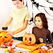 Stock Photo: Halloween party with children holding trick or treat.