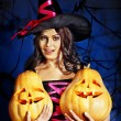 Witch holding pumpkin — Stock Photo #32111733