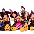 Stock Photo: Halloween party with group kid holding carving pumpkin.