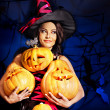 Witch holding pumpkin — Stock Photo #32111781